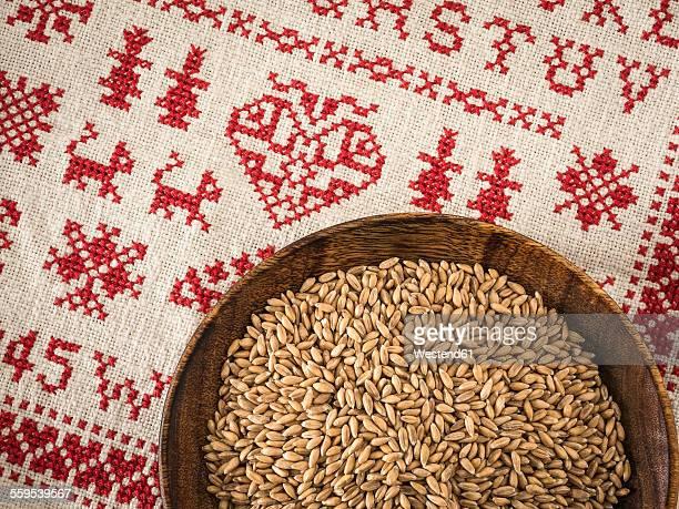 Bowl of spelt grains on cross stitch doily