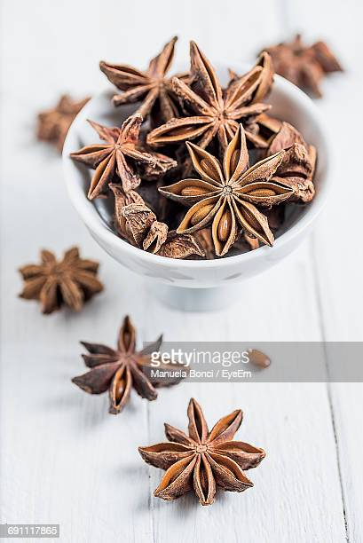 Bowl Of Star Anise On Wooden Table