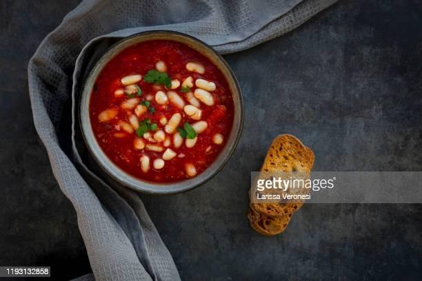 bowl of stew with cannellini beans - larissa veronesi stock-fotos und bilder