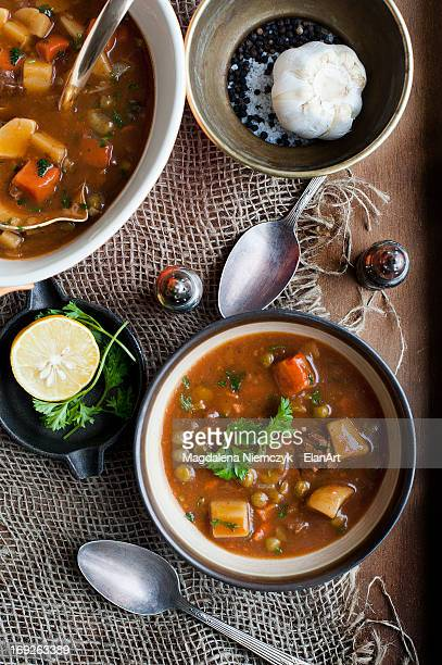 Bowl of stew with garlic and lemon