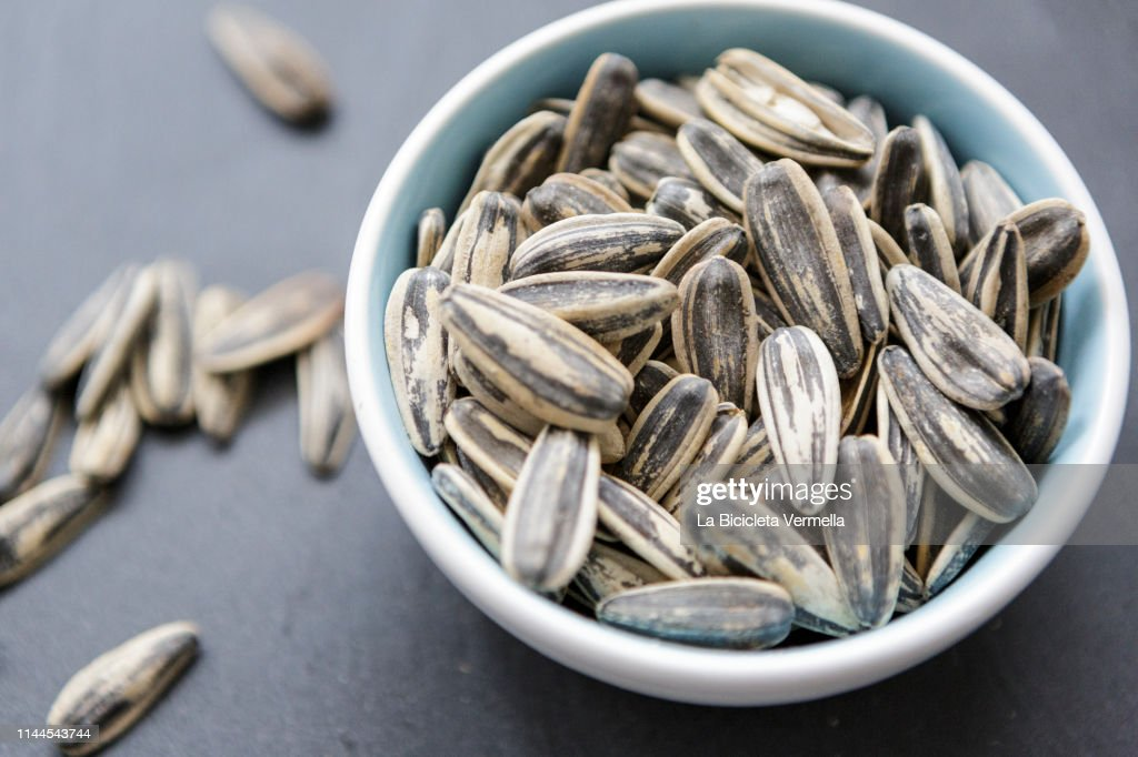 Bowl of sunflower seeds : Stock Photo