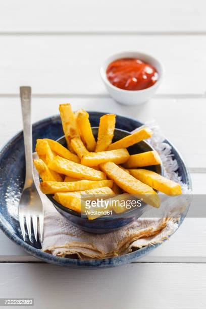 bowl of swede fries and bowl of ketchup - rutabaga stock pictures, royalty-free photos & images