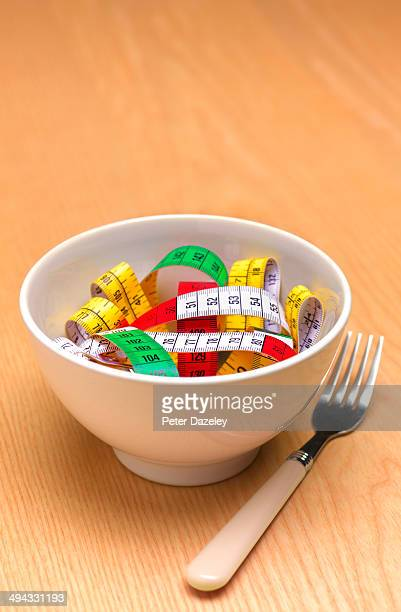 bowl of tape measure pasta - anorexia nervosa stock photos and pictures