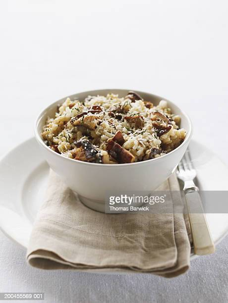 Bowl of three-mushroom risotto with asiago and parmesan cheese
