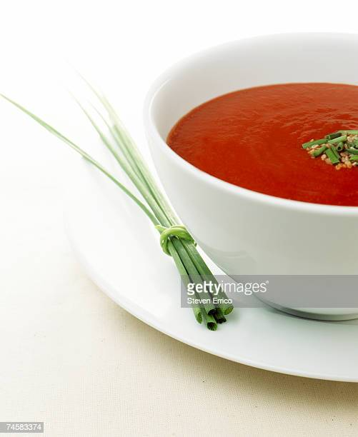 bowl of tomato soup, chives on plate, close-up - チャイブ ストックフォトと画像