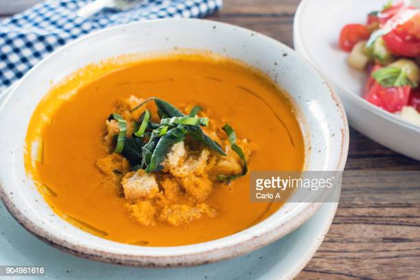 bowl of tomato soup - crouton stock photos and pictures