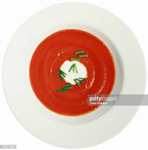 Bowl of tomato soup with crème fraîche and chive
