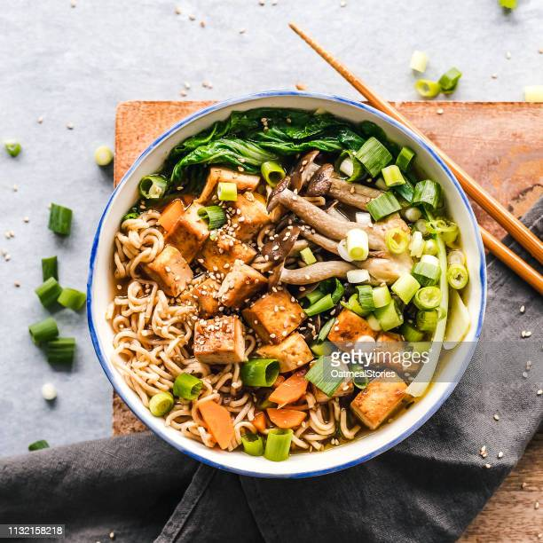 bowl of vegan miso ramen with tofu and mushrooms - 深皿 ストックフォトと画像