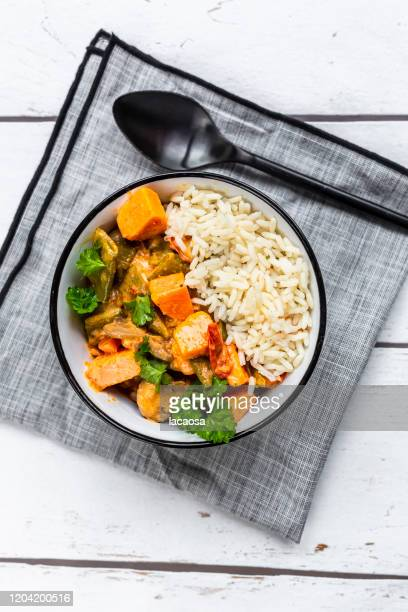 bowl of vegan sweet potatoe curry with rice - curry meal stock pictures, royalty-free photos & images