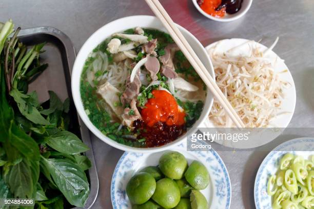Bowl of Vietnamese noodle soup known as Pho Ho Chi Minh City Vietnam