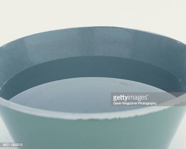 bowl of water - wash bowl stock pictures, royalty-free photos & images