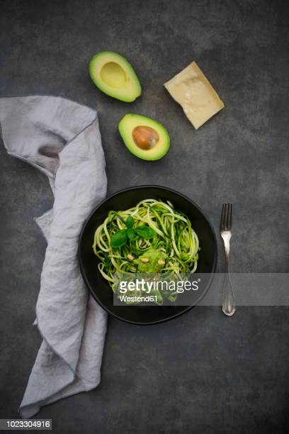 bowl of zoodels with avocado basil pesto - marrow squash stock pictures, royalty-free photos & images