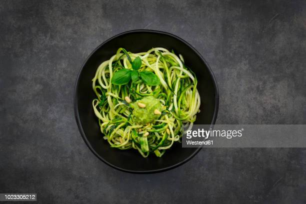 bowl of zoodels with avocado basil pesto - pasta stock pictures, royalty-free photos & images