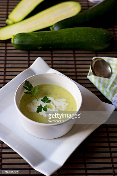 bowl of zucchini potato soup - flat leaf parsley stock pictures, royalty-free photos & images