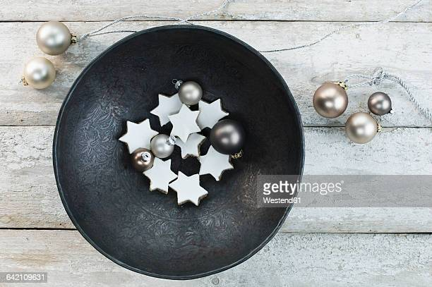 Bowl with Christmas baubles and cinnamon stars