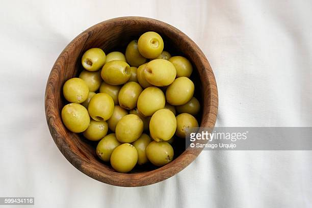 bowl with green olives - olives stock photos and pictures