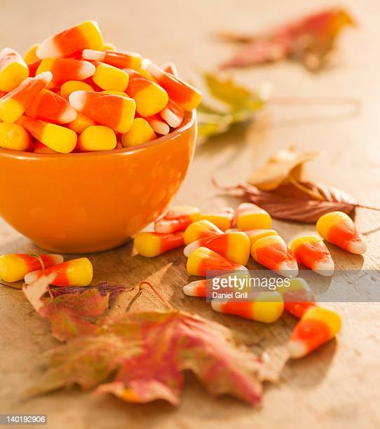 bowl with halloween candies - bowl of candy stock photos and pictures