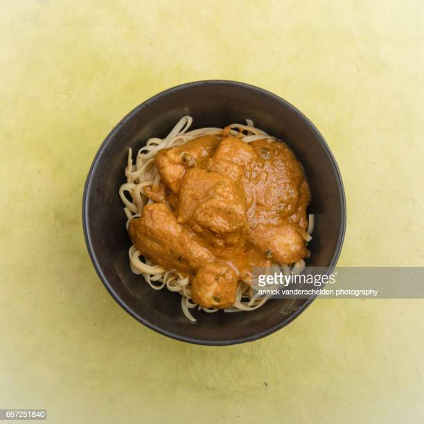 Bowl with noodles and curry.