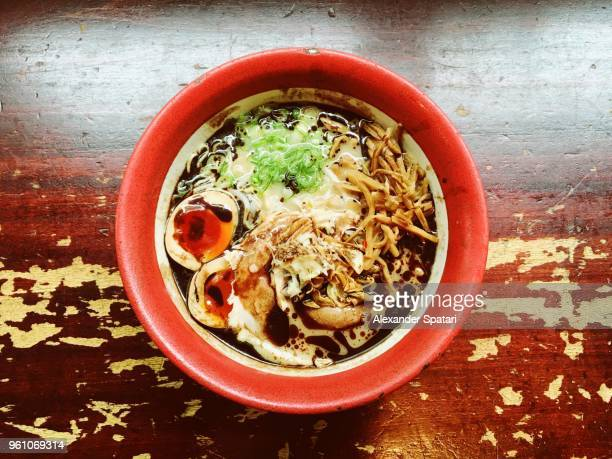 bowl with ramen soup, directly above view - japanese food stock pictures, royalty-free photos & images