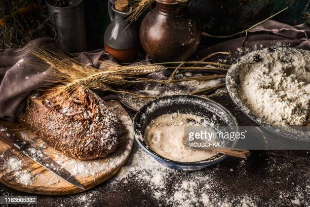 bowl with sourdough bread sour on rustic table - fermenting stock pictures, royalty-free photos & images