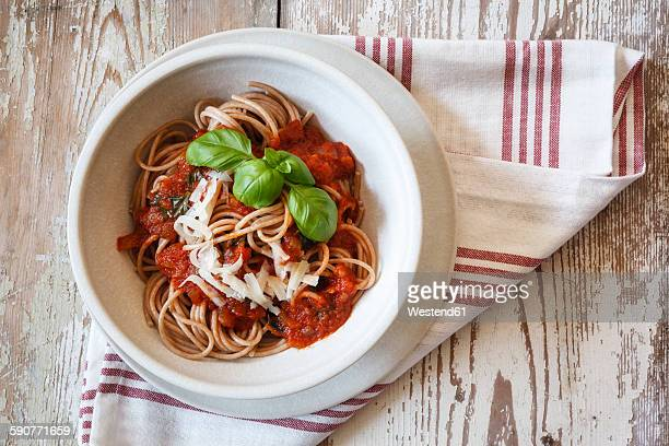 Bowl with spelt whole grain spaghetti, tomato sauce, parmesan and basil
