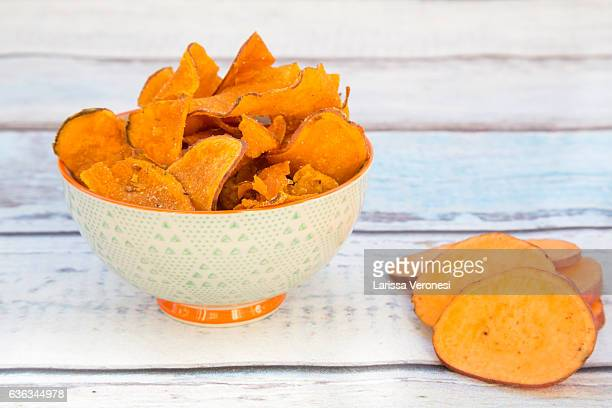 bowl with sweet potato chips - sweet potato stock pictures, royalty-free photos & images