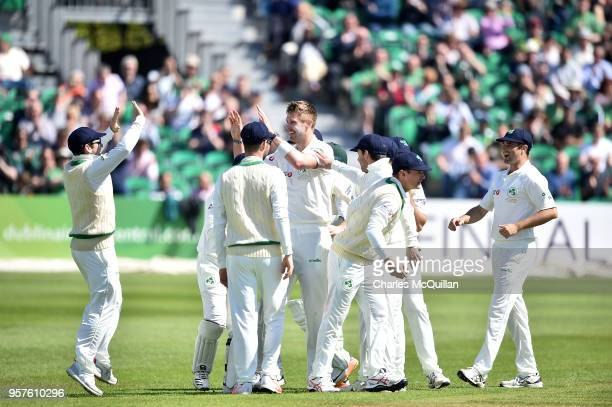 Bowler Boyd Rankin of Ireland celebrates as Ireland take their first ever test wicket during the Ireland v Pakistan test cricket match on May 12 2018...