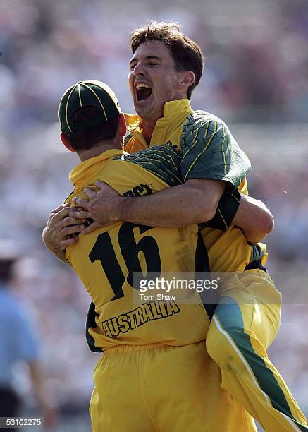 Bowler Brad Hogg of Australia celebrates with Michael Kasprowicz after he caught Andrew Flintoff of England during the NatWest Series One Day...