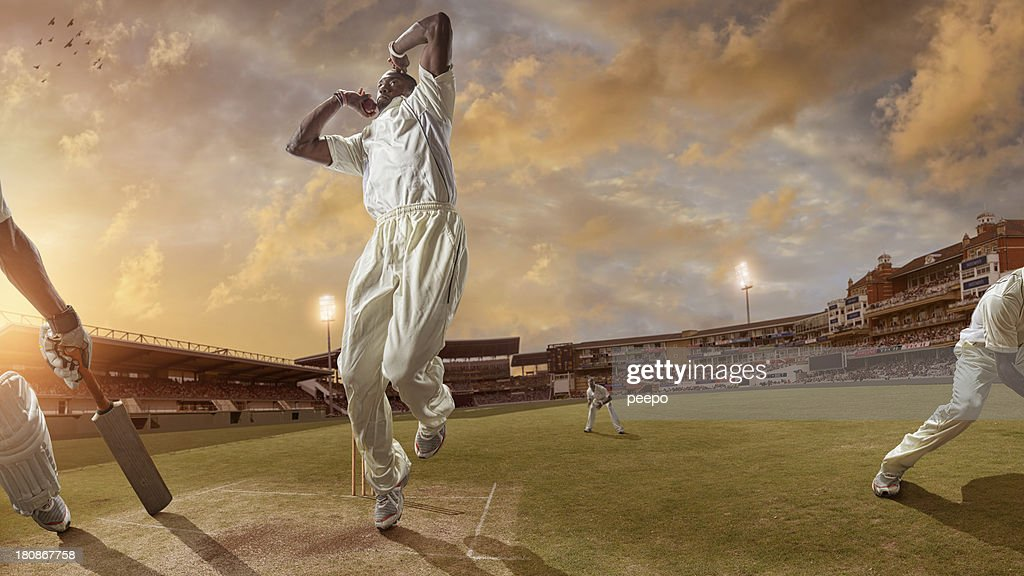 Bowler Delivering a Fast Ball During a Cricket Game : Stock Photo