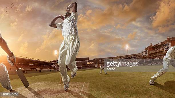 bowler delivering a fast ball during a cricket game - cricket stock pictures, royalty-free photos & images