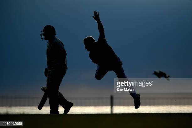 A bowler from Menheniot/Looe CC runs in to bowl during the Cornwall Cricket League Division 2 East match between Bude CC and Menheniot/Looe CC at...