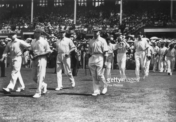 Bowler Gubby Allen George Oswald Browning Allen leading out his England side for the final test match against Australia at Melbourne 10th March 1937...