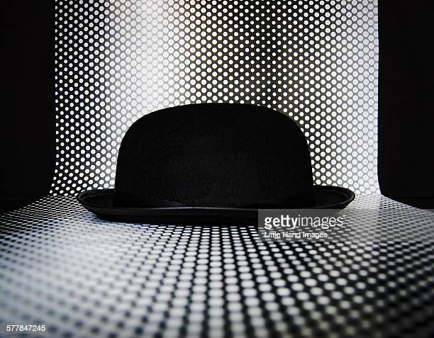 bowler hat with dots - rene magritte stock pictures, royalty-free photos & images