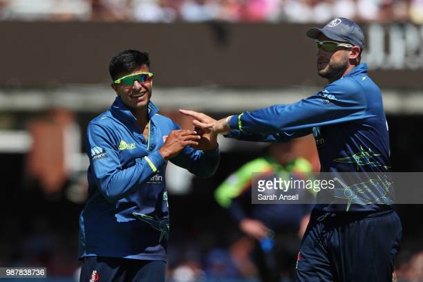 Bowler Imran Qayyum of Kent celebrates with teammate Alex Blake after taking the wicket of James Vince of Hampshire during the Royal London OneDay...