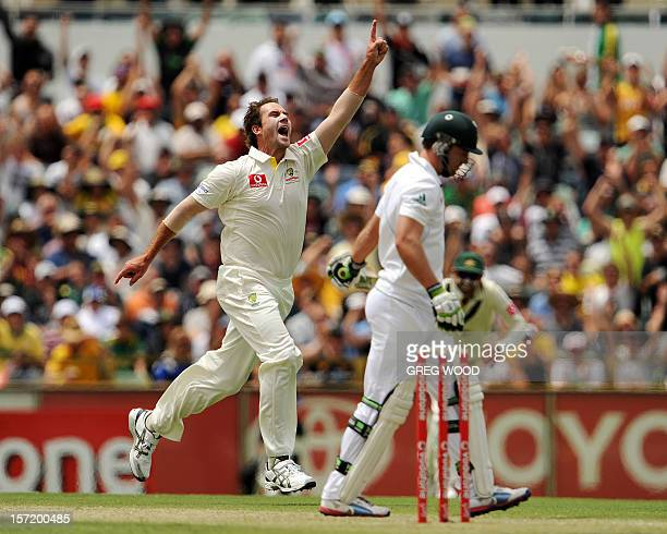 Bowler John hastings celebrates after taking the wicket of South African batsman AB Devilliers on day one of the third cricket Test between South...