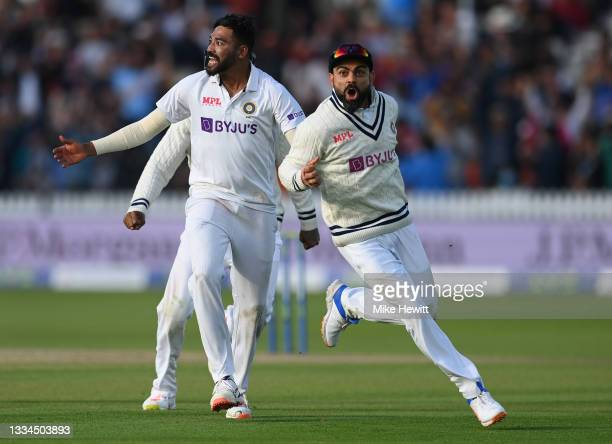 Bowler Mohammed Siraj and captain Virat Kohli of India celebrate the crucial wicket of Jos Buttler of England during the Second LV= Insurance Test...