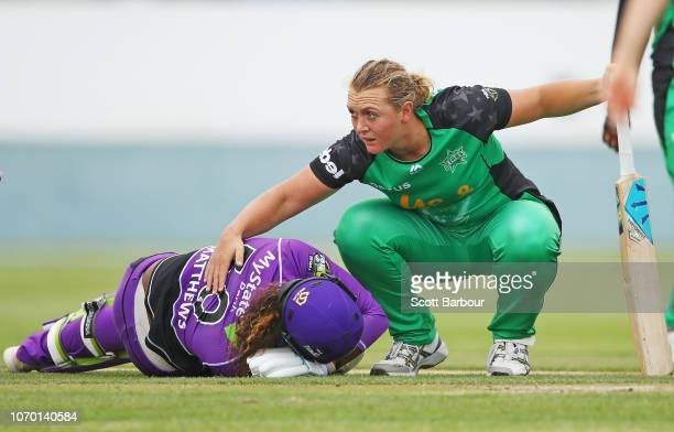 Bowler Nicola Hancock of the Stars consoles Hayley Matthews of the Hurricanes after running her out and Matthews injured herself during the Women's...