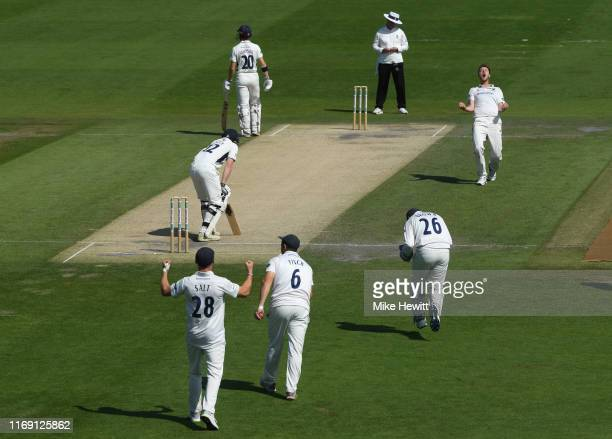 Bowler Ollie Robinson of Sussex celebrates the wicket of Sam Robson of Middlesex caught at 2nd slip by Harry Finch during the Specsavers County...