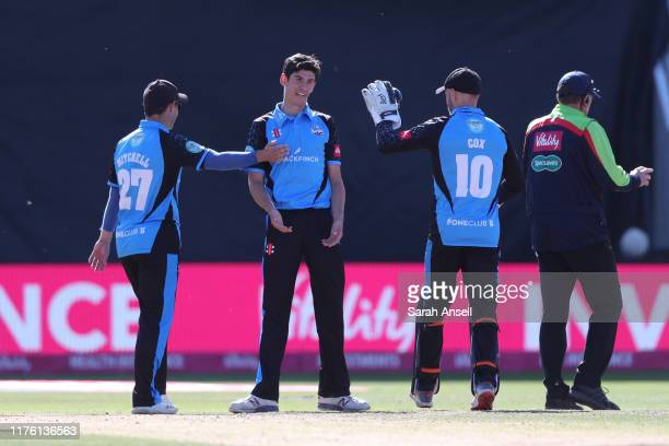 Bowler Pat Brown of Worcestershire Rapids is congratulated by teammates Daryl Mitchell and Ben Cox after dismissing Tom Moores of Notts Outlaws...