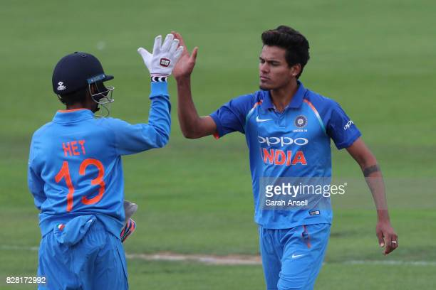 Bowler Rahul Chahar of India U19s celebrates with wicket keeper Het Patel after they combine to dismiss Liam Banks of England U19s during the match...