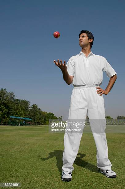 bowler tossing a ball - cricket player stock pictures, royalty-free photos & images