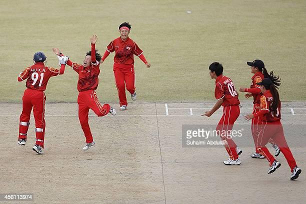 Bowler, Zhou Haijie of China celebrates with teammates after dismissing Lasanthi Heenatigala Madinage of Sri Lanka during the cricket women's bronze...