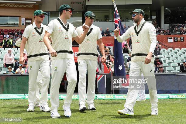 Bowlers Pat Cummins, Mitchell Starc, Josh Hazlewood and Nathan Lyon of of Australia walk onto the field at the start of play during day four of the...