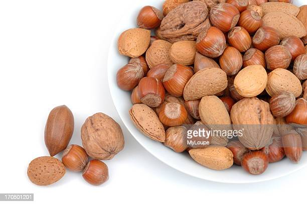 Bowlful Of Walnuts Almonds And Hazelnuts With Few Nuts Fallen Off
