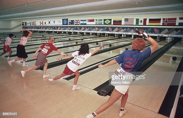 1988 Summer Olympics Rear view of athletes in action simultaneously throwing out first balls before Individual competition at Royal Bowling Center...