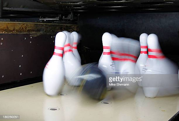 A bowling ball hits pins at the Tapatio Bowling Alley during Day 11 of the XVI Pan American Gameson October 25 2011 in Guadalajara Mexico
