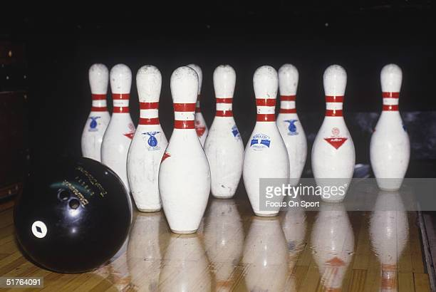 A bowling ball rolls towards the pins during a bowling game circa 1980