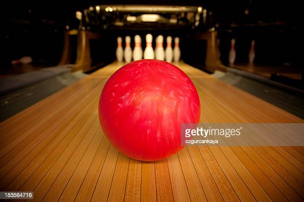 Bowling ball set in front of ten pins