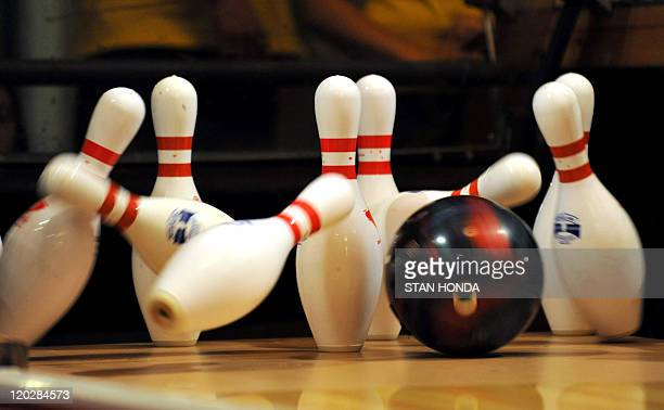 A bowling ball strikes the pins in the 14th Annual Teen Masters Championship on August 3 2011 at Grand Central Terminal in New York A temporary...