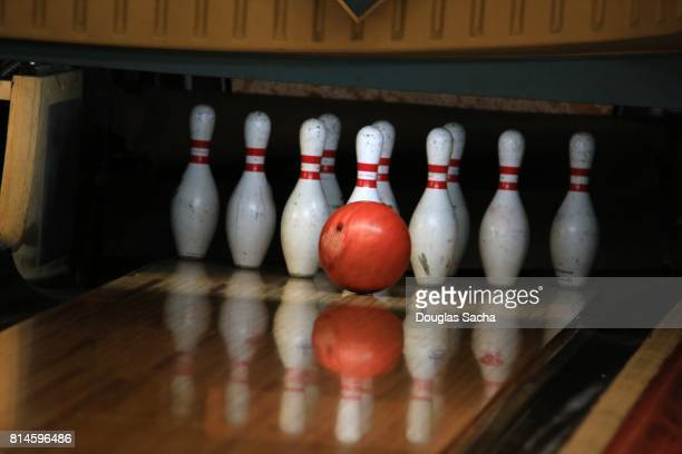 Bowling ball striking the Alley pins